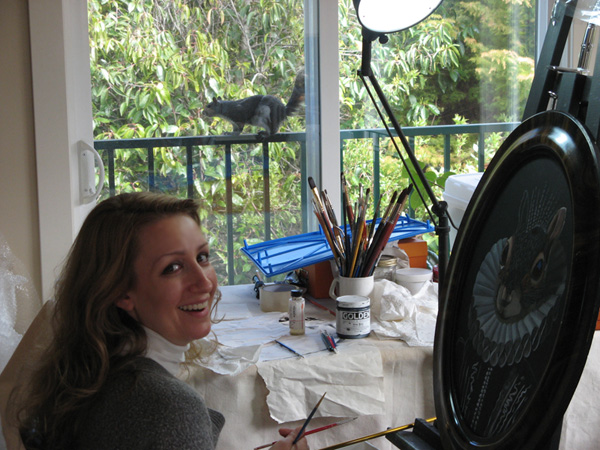 Artist, Carollyne Yardley with squirrel subject and painting