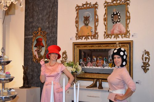 Red Hat (Tierre Joline) and Mushroom Hat (Danica Wilcox) in front of Never Dine Alone: Squirrel Banquet