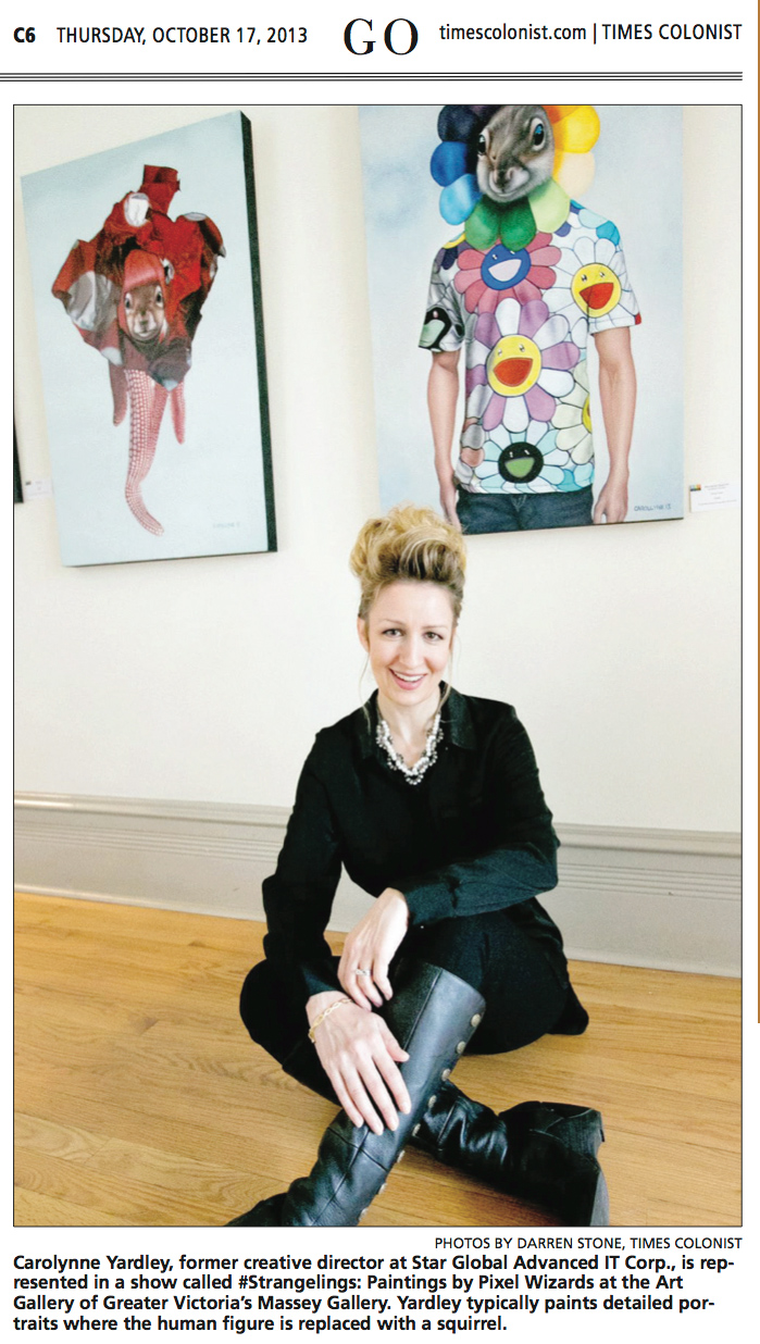 Carollyne Yardley in front of paintings for #Strangelings: Paintings by Pixel Wizards. Photo by Darren Stone, Times Colonist. Oct 17, 2013.