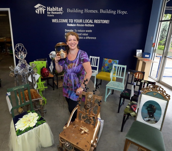 Yolanda Meijer shows off some of the decorated chairs at the new ReStore outlet.   Photograph By BRUCE STOTESBURY, Times Colonist - See more at: http://www.timescolonist.com/business/artful-idea-opens-habitat-s-newest-restore-on-oak-street-1.2031594#sthash.CyY96nFW.dpuf