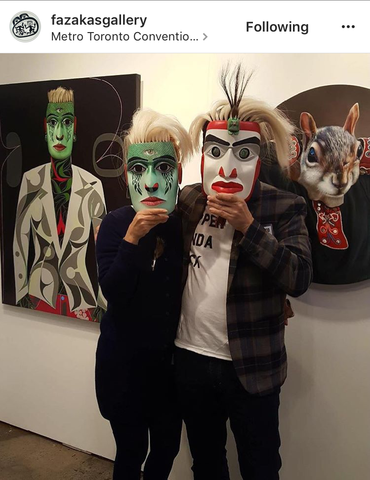 Carollyne Yardley and Rande Cook wearing the collaboration masks.