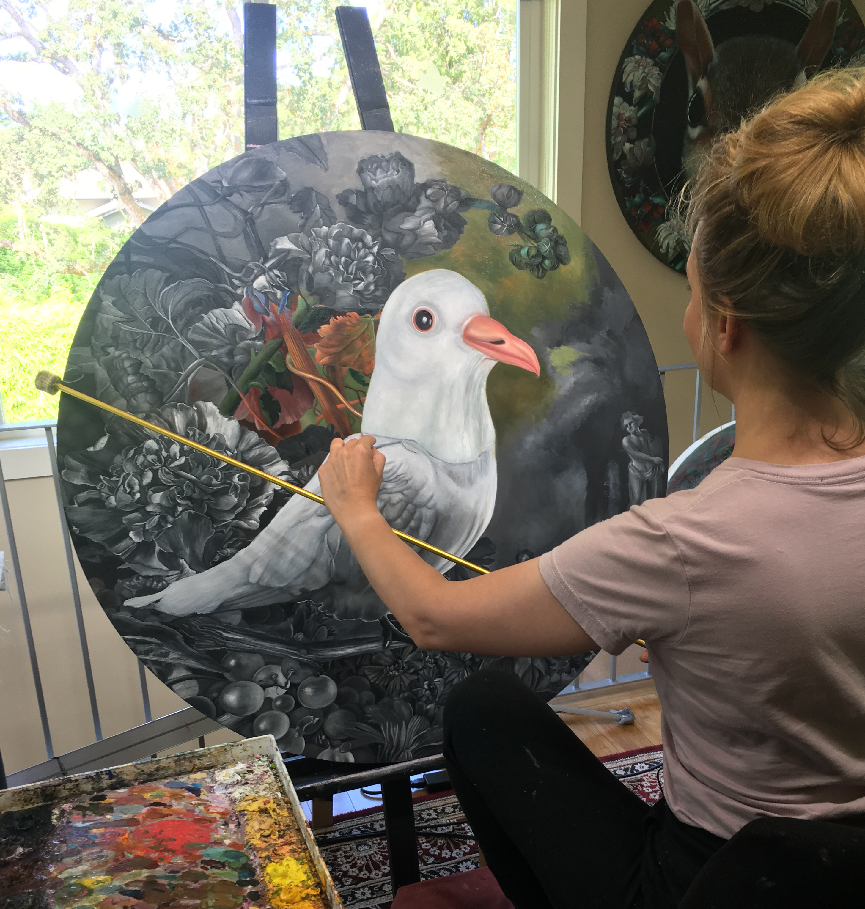 "Carollyne Yardley working on Holy Spirit Wears a Dove Mask II (2018) Commission. Oil on panel, 36"" diameter. Photos and high resolution details. #contemporaryart #dove #carollyneyardley #oilpainting"