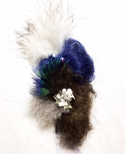 Peacock feathers, dyed human hair, untreated human hair, salt and borax crystals, cypress tree, hat pin, 6″ x 3″, 2019.