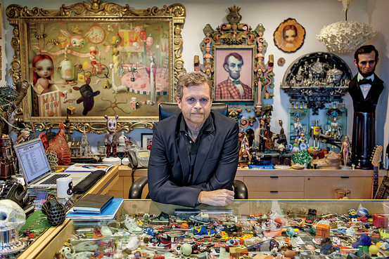 8:00 a.m. | Parker's explosively cluttered office—which includes items ranging from Jimi Hendrix's Fender Stratocaster to Olympic sprinter Michael Johnson's gold shoes—reflects the CEO's eclectic design sensibility. Photography by Michael Friberg