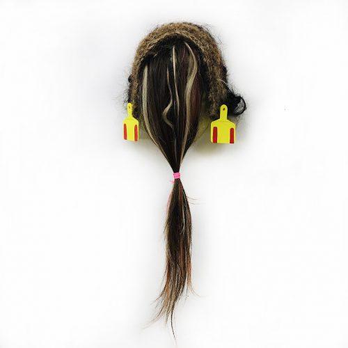 Urban Deer Hunter, 2020 detail. Human hair, agriculture ear tags, pink flagging tape